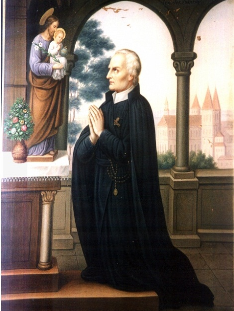 Padre Passerat in preghiera.